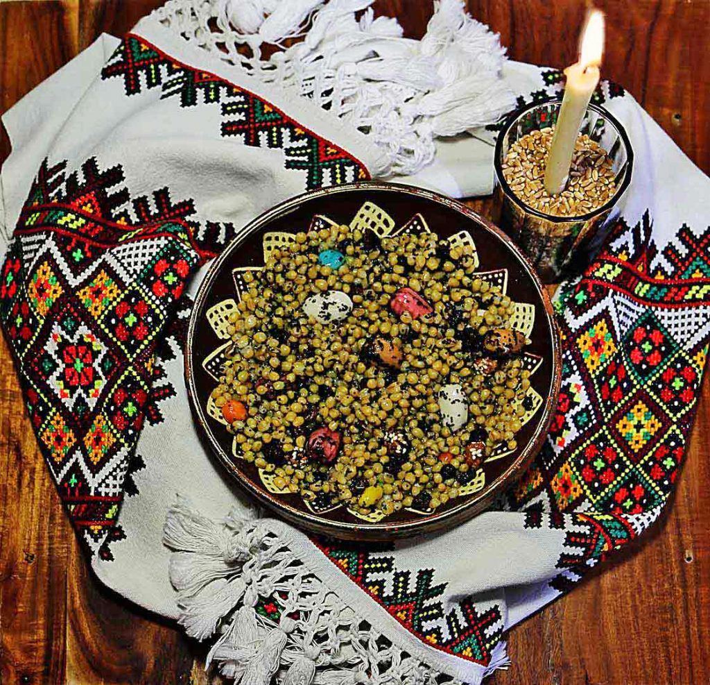 Ukrainian Christmas Eve kutia, rushnyk and candle on a wooden table